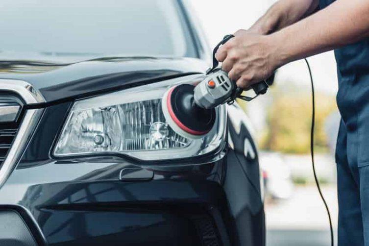 mobile car washer completing headlight restoration